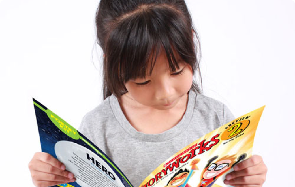Second grade student reads Storyworks 2 magazine
