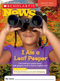 Scholastic News Edition 2 magazine cover of a young girl looking at leaves through binoculars